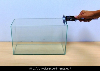 Fig. 3: Measuring the thickness of the container wall